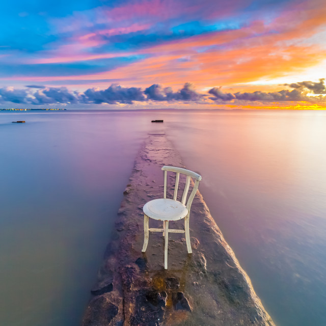 """""""Chair on a Jetty in the sunrise"""" stock image"""