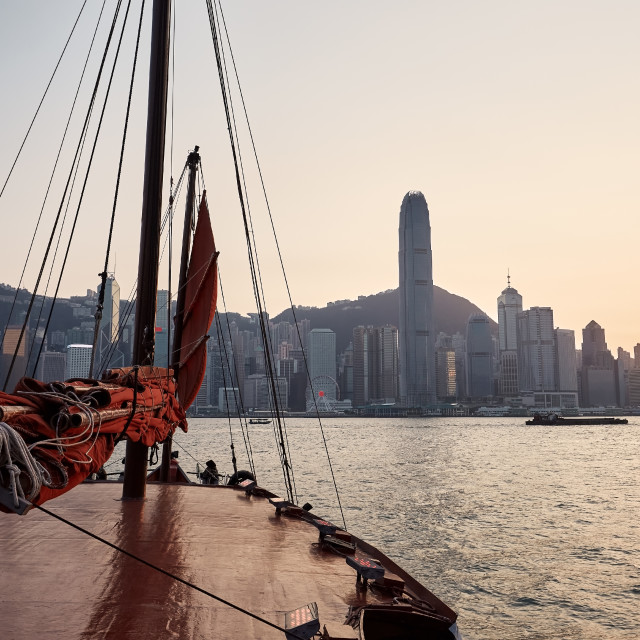 """""""Traditional Junk boat against Hong Kong cityscape"""" stock image"""