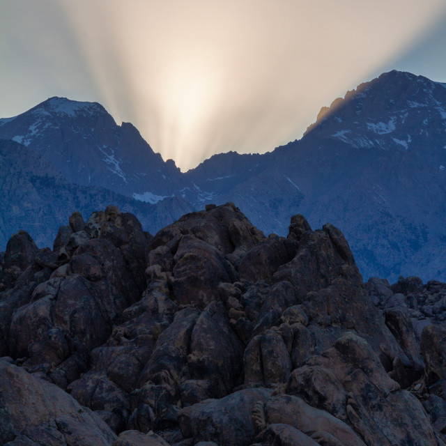 """""""Dramatic light rays over the mountains"""" stock image"""