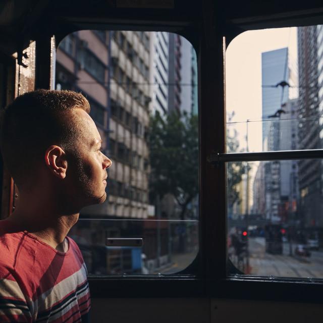 """Tourist exploring city streets of Hong Kong"" stock image"