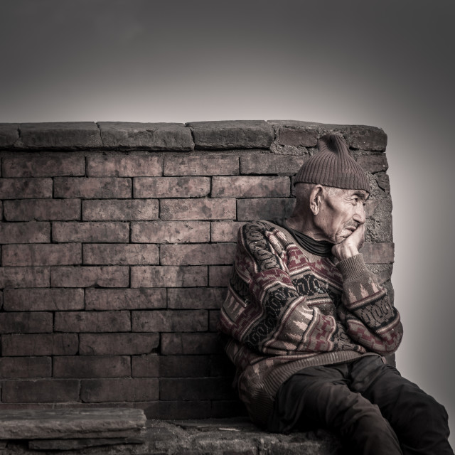 """""""old man against wall"""" stock image"""