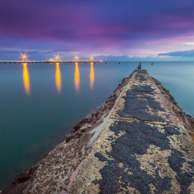 """""""Long exposure shot of a pier at sunrise"""" stock image"""