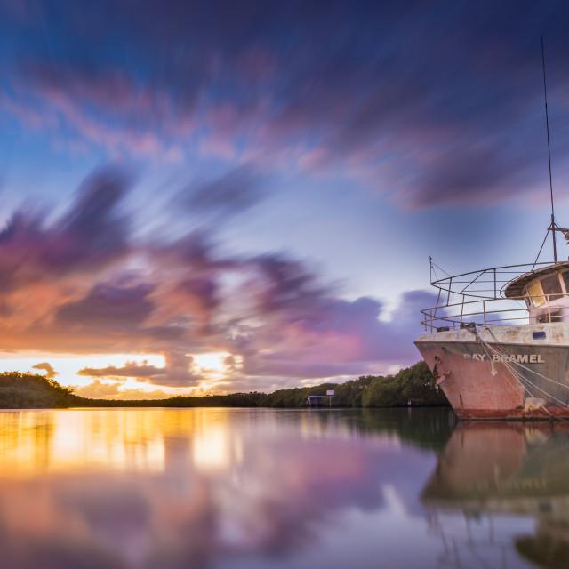 """Old Trawler in the sunrise"" stock image"