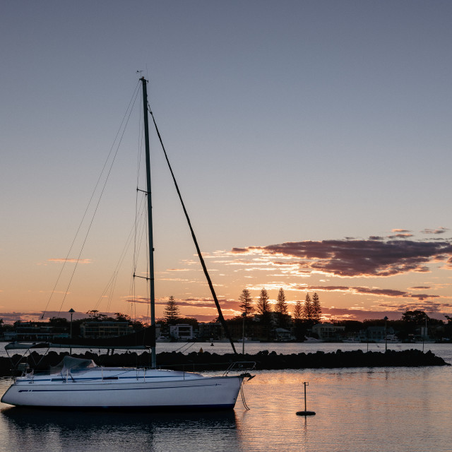 """""""Lone yacht at sunset // Forster Marina, NSW"""" stock image"""
