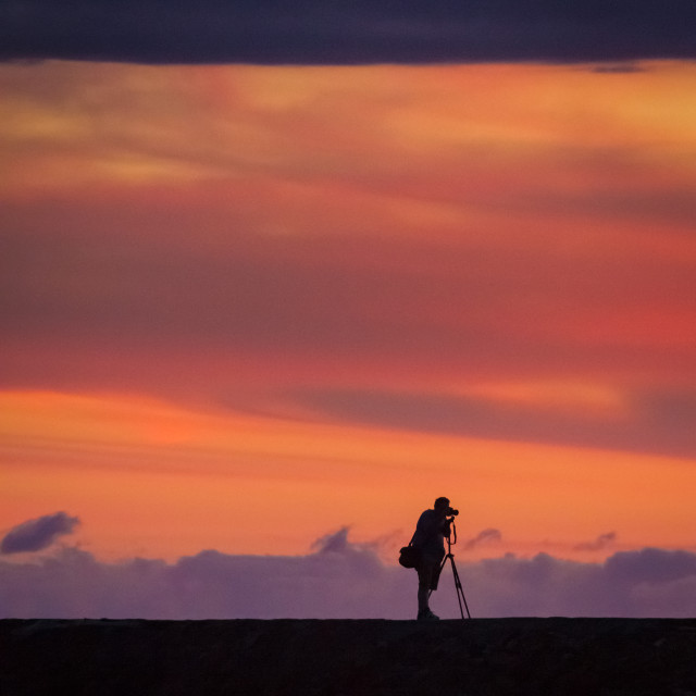 """""""Photographer in the sun rise"""" stock image"""