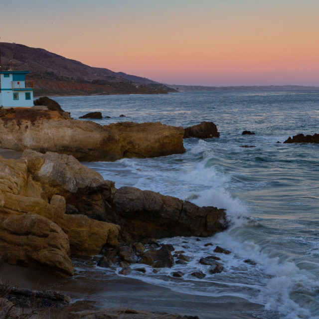 """""""Sunset over a lifeguard station in Malibu"""" stock image"""