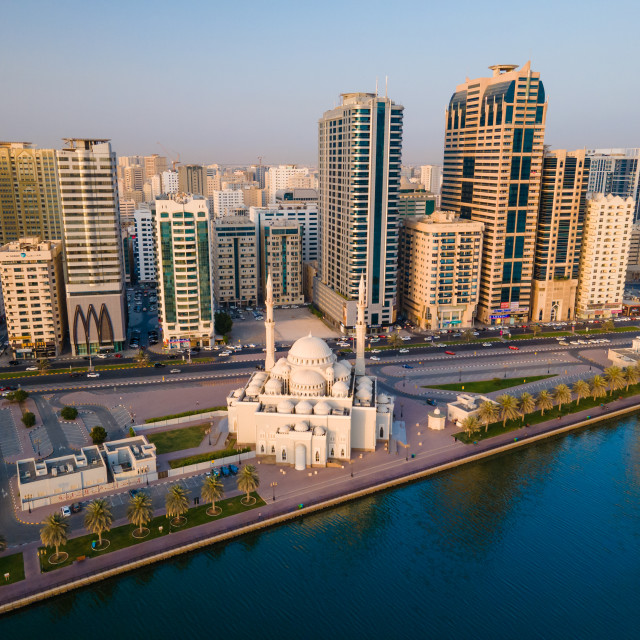 """""""Sharjah aerial view above Al Noor island and mosque and downtown rising above Khalid lake"""" stock image"""