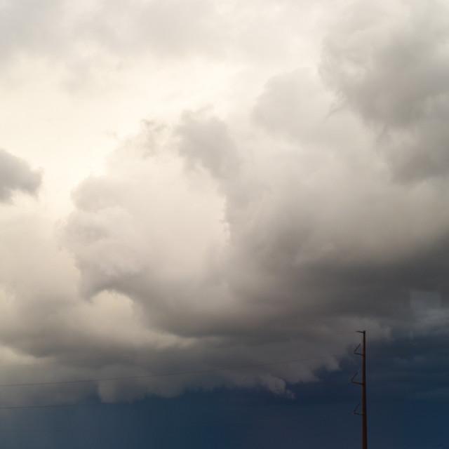 """Cloudy Telephone Poles"" stock image"