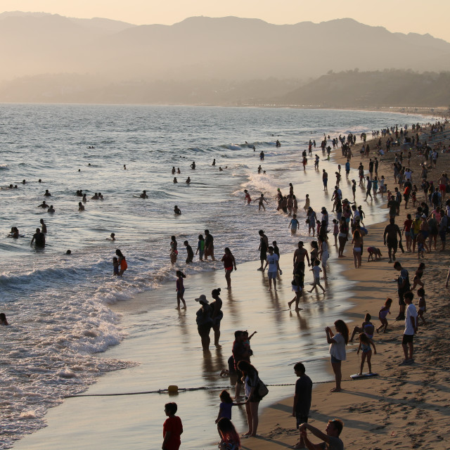 """""""California Beach Crowded at Sunset"""" stock image"""