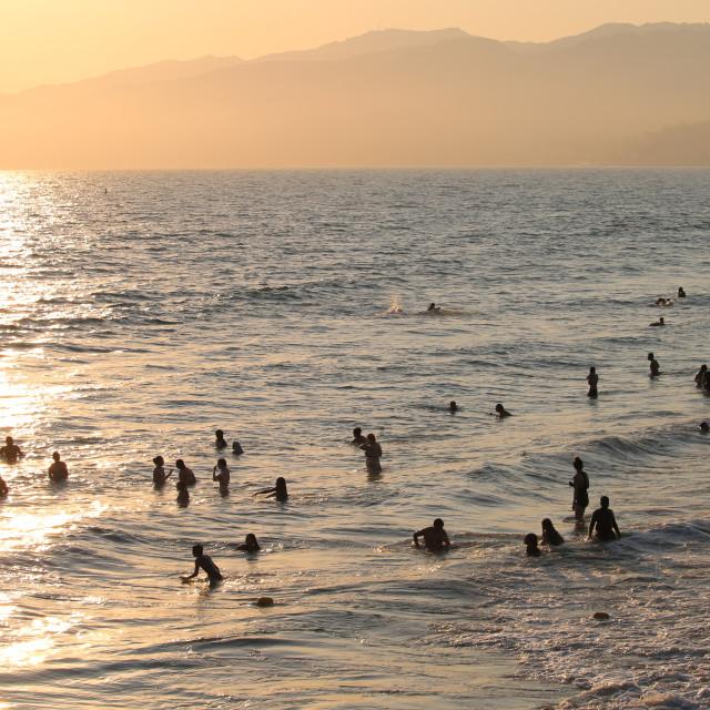 """""""Beachgoers at Sunset"""" stock image"""
