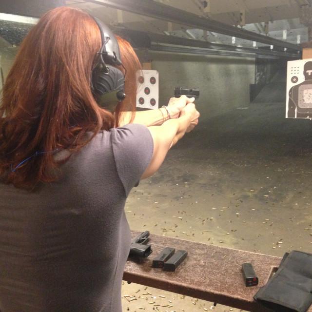 """Woman Shooting Handgun"" stock image"