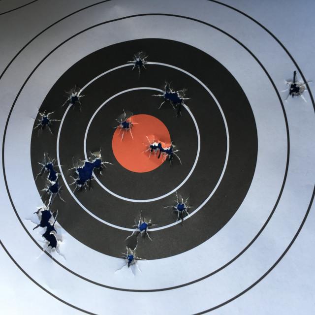 """Bullet Holes in Paper Target"" stock image"