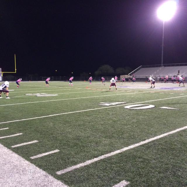 """Junior American Football Game at Night"" stock image"