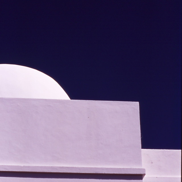 """White Building Against Blue Sky"" stock image"