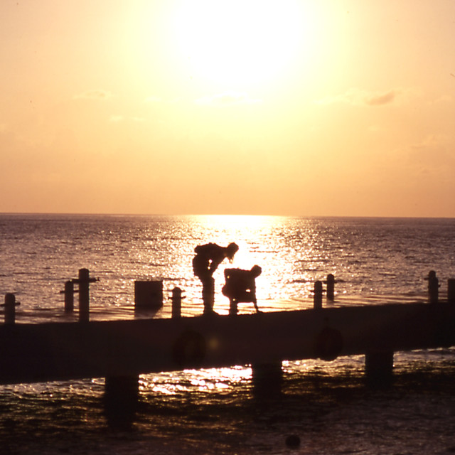 """""""Couple at Sunset on Pier"""" stock image"""