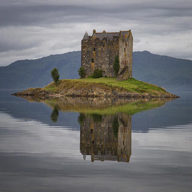 """Reflecting on Castle Stalker"" stock image"