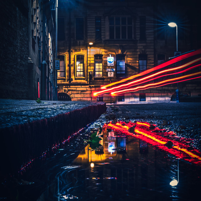 """""""Light trail reflections from Tennis Court Road, Cambridge UK."""" stock image"""