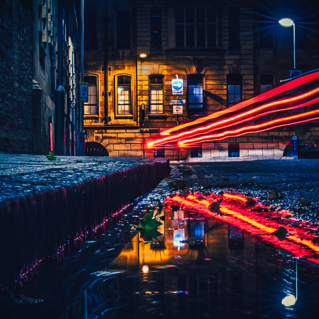 """""""Light Trail Reflections from Tennison Court Road, Cambridge UK."""" stock image"""