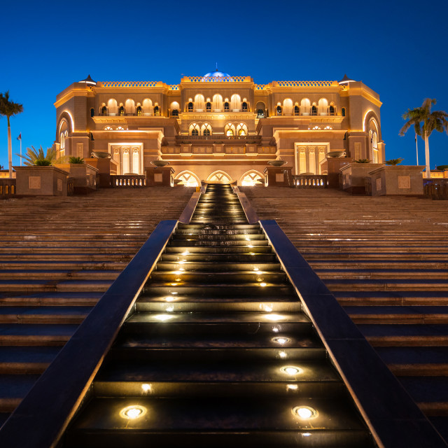 """""""Emirates palace entrance in Abu Dhabi , night view of one of the famous travel spots and landmarks in United Arab Emirates capital city at blue hour"""" stock image"""