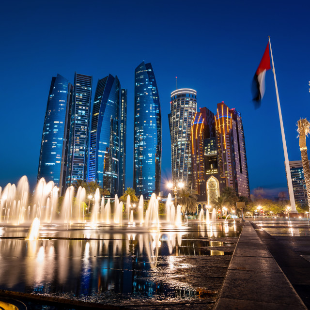"""""""Abu Dhabi downtown skyline with iconic skyscrapers rising above corniche area in al Bateen, named Etihad towers, representing wealth and development of the United Arab Emirates capital city"""" stock image"""