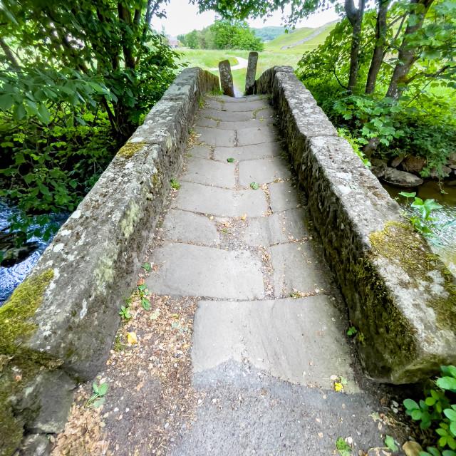 """""""Packhorse Bridge, Crossing Captain Beck, Linton in Craven."""" stock image"""