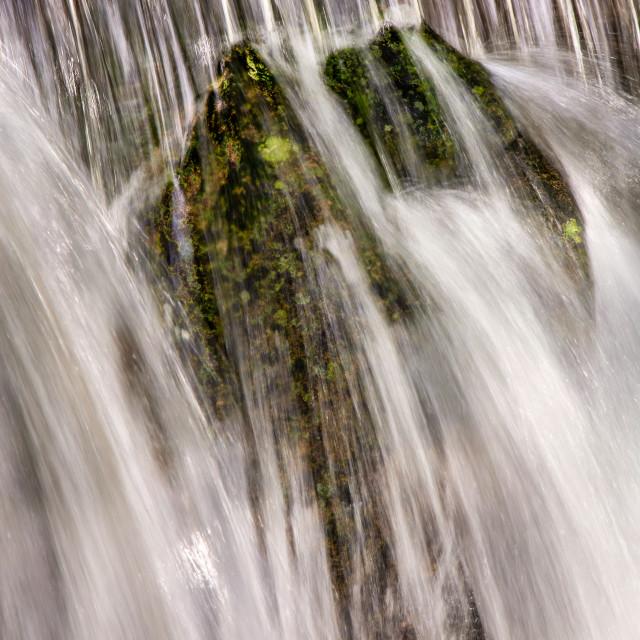 """Beautiful veil cascading waterfalls, mossy rocks"" stock image"