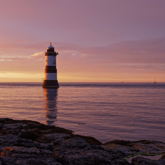"""Penmon Lighthouse at Sunset"" stock image"