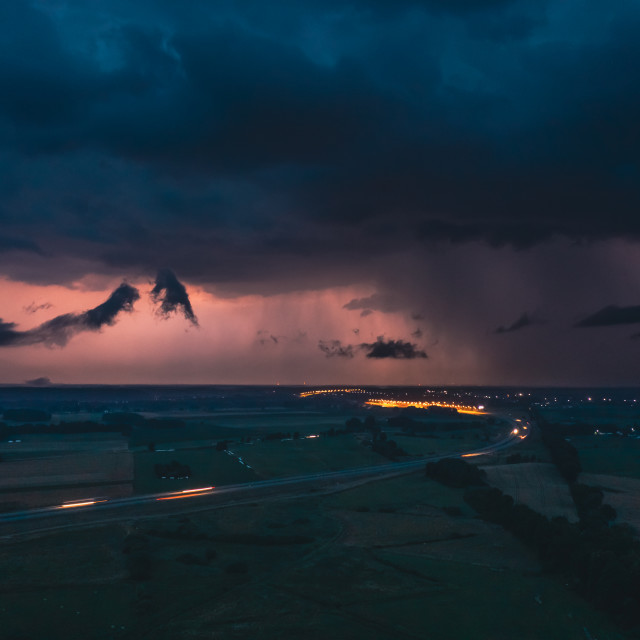 """""""Heavy storm over express road and fields, dark clouds and lightning in the evening"""" stock image"""