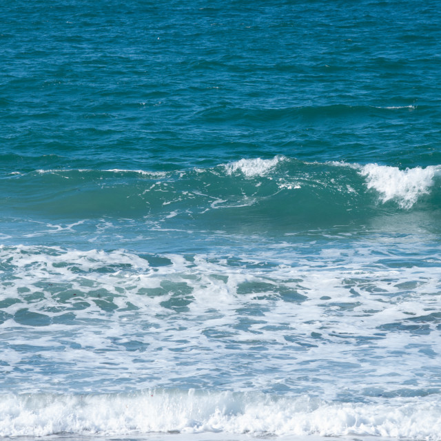"""Breaking waves at the sea edge, Cornwall"" stock image"