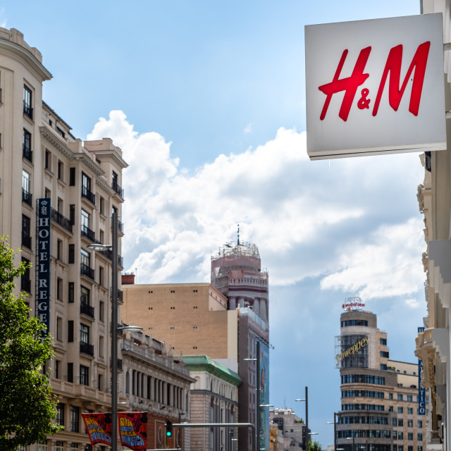 """""""H&M fashion store sign in Gran Via against cityscape in Madrid"""" stock image"""