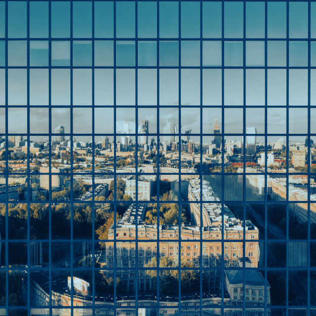 """""""Aerial view of Warsaw city center reflecting in office building with green windows"""" stock image"""
