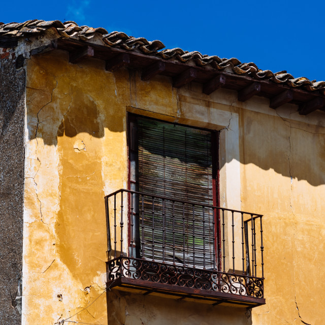 """""""Old Iron Balcony in Aged Yellow Plaster Facade"""" stock image"""