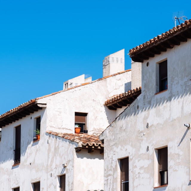 """""""Old weathered white facades agaisnt blue sky"""" stock image"""
