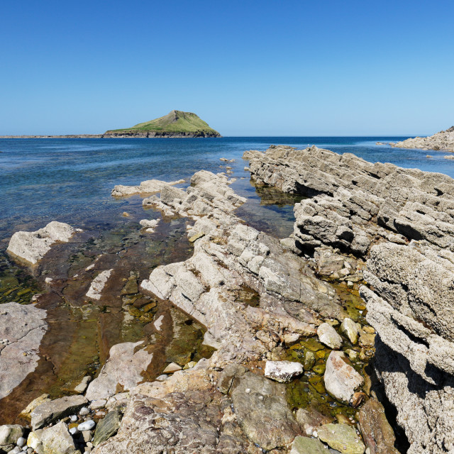 """Jagged rocks at Worms Head Rhossili"" stock image"