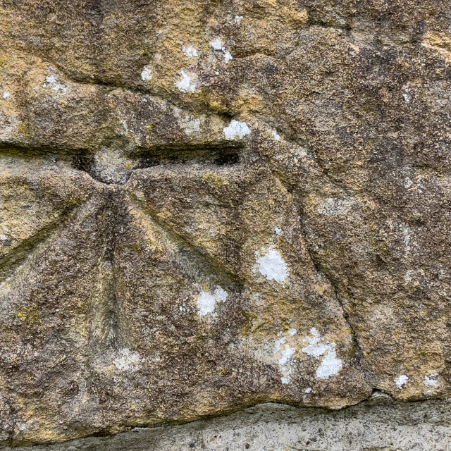 """""""Benchmark at Parish Church, St Michael and All Angels, Linton in Craven."""" stock image"""