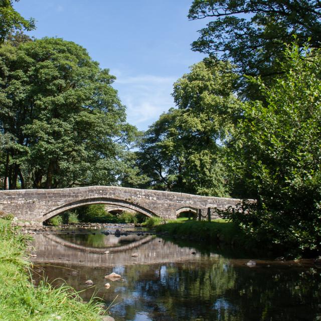 """Packhorse Bridge over Linton Beck, Linton in Craven, Yorkshire Dales."" stock image"