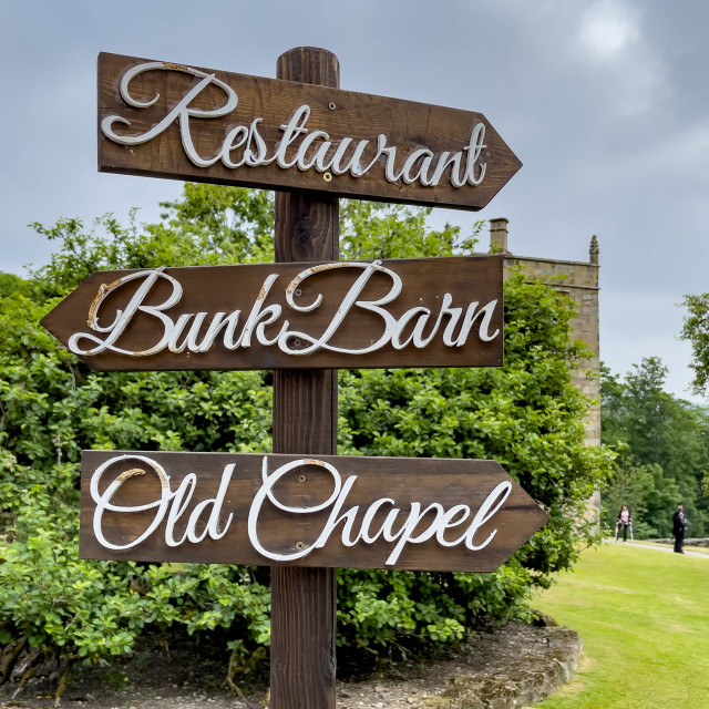 """""""Restaurant, Bunk Barn, Old Chapel Direction Sign, Barden Tower."""" stock image"""