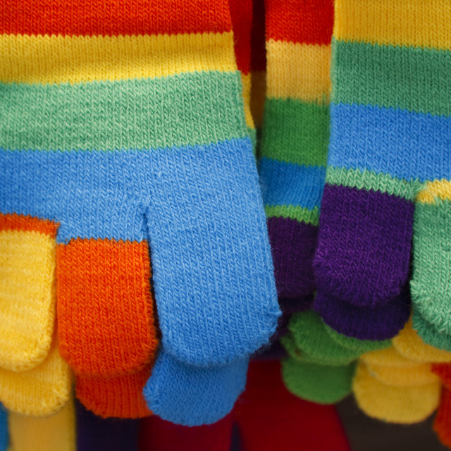 """""""Knitted striped winter gloves in bright colors"""" stock image"""