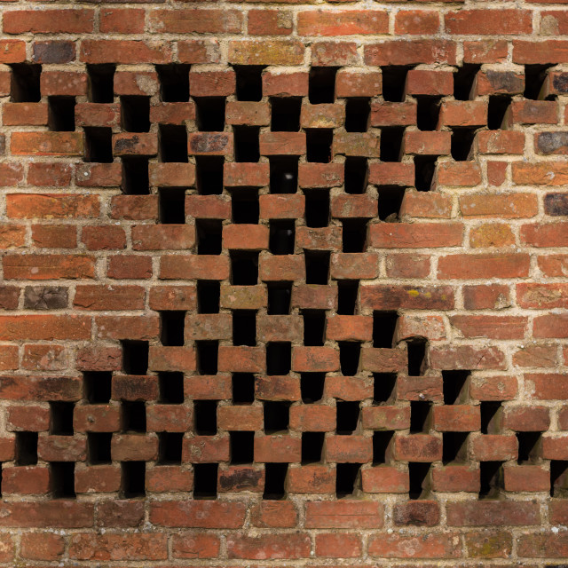 """""""Old red brick wall with decorative detail x shape, Norfolk, UK"""" stock image"""