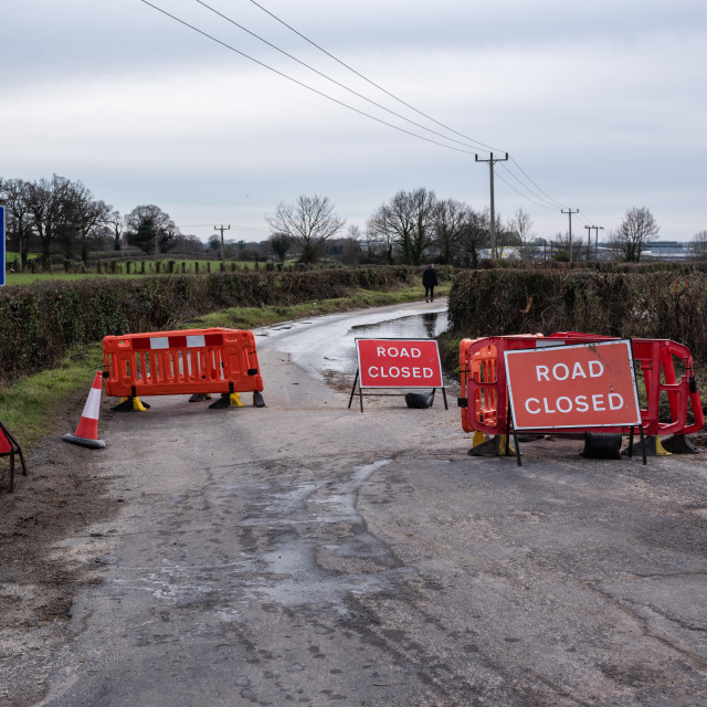 """""""Road closed, Low bridge, and flood signs on Green Lane North, Th"""" stock image"""