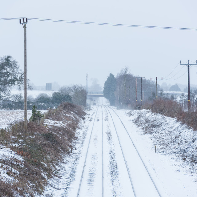 """""""Bittern Line Norwich to sheringham railway tracks in snow at Gre"""" stock image"""