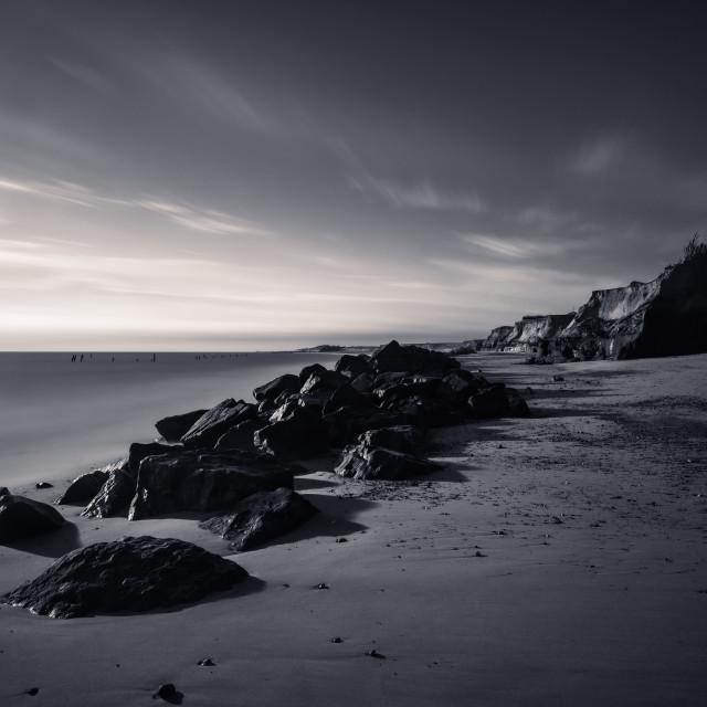 """Long exposure mono of sea defence rocks on Happisburgh beach, No"" stock image"