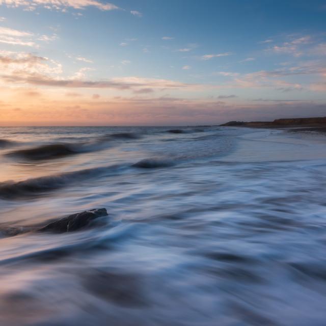 """Soft sunrise glow at Happisburgh beach, Norfolk"" stock image"