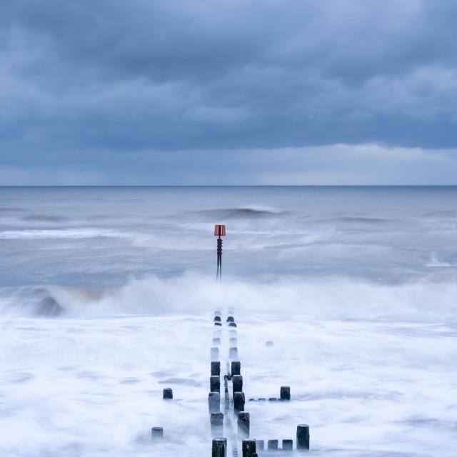 """Sea defences seascape at Cart Gap, Norfolk i"" stock image"