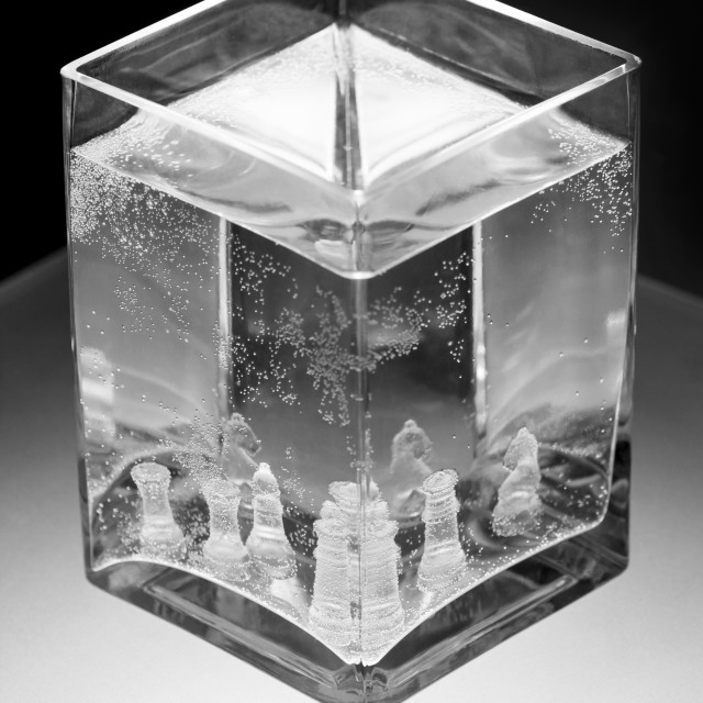 """""""Glass chess pieces in water"""" stock image"""