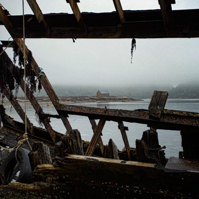 """Fishing Bothy Seen Through the Shipwreck, Lower Diabaig"" stock image"