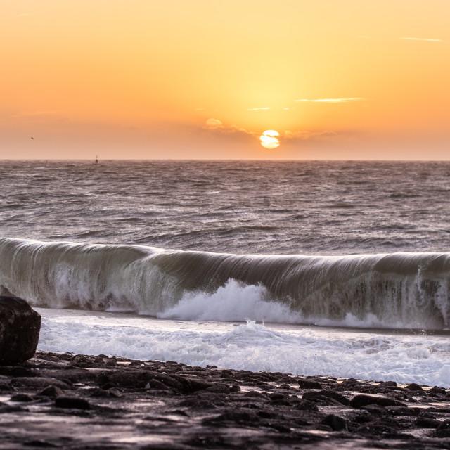 """""""Crashing waves sunset"""" stock image"""