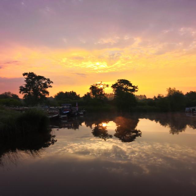 """Sunrise over the lake"" stock image"