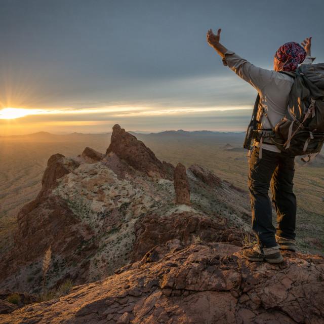 """Hiker Enjoying a Mountain Sunset"" stock image"