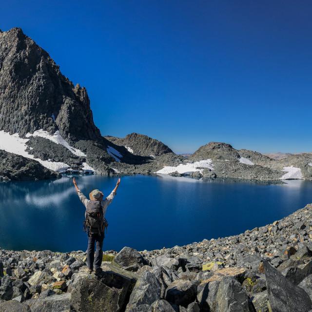 """Hiker Enjoying Lake Catherine and Mount Ritter"" stock image"